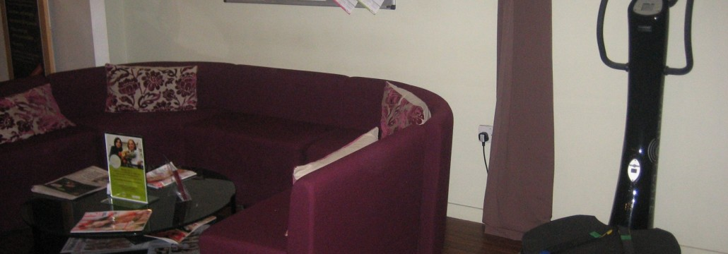 A power plate lurks among the sofas in reception