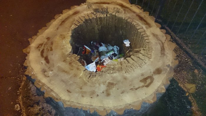 Tree stump bin