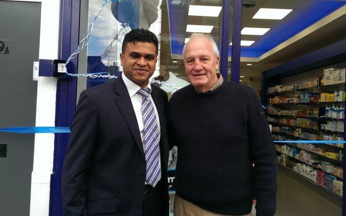 Pharmacy owner Sanjay Patel with John Emburey