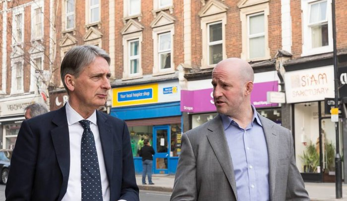 Simon Marcus (right) walks down West End Lane with Foreign Secretary Philip Hammond