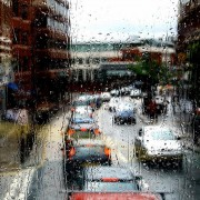 Rainy bus window view of West End Lane via Luca Marengo
