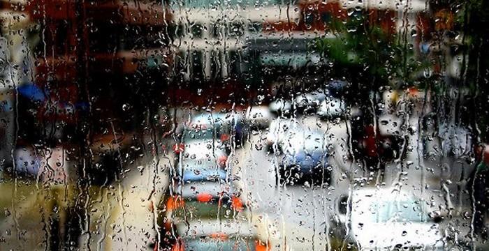 Rainy bus window view of West End Lane via Luca Marengo
