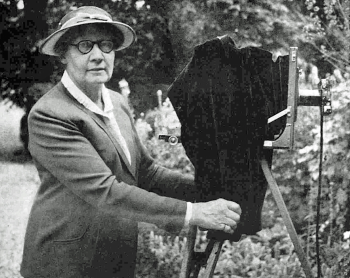 Miss Compton Collier with her plate camera